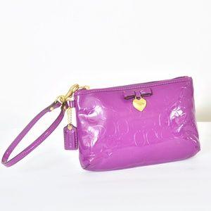 Purple Coach Wristlet Bag